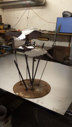 Flying Pheasant with tall grass in bare metal. We can powder coat it in any color or leave it to rust naturally. Approx. 36 inches tall and when the wind blows the pheasants seem to be flying. $110.00