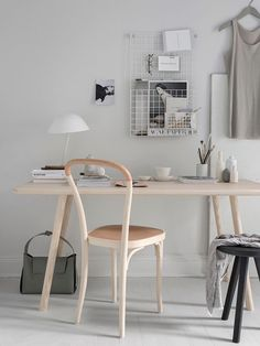Minimalist workspace | soft grey workspace | pale wood desk | wire storage rack | TDC : Friday Finds | Soft Minimalism by Pella Hedeby + Sara Medina Lind: