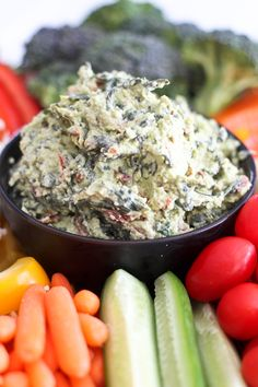 "Healthy Spinach Avocado Dip. ""A dip that's as good for you as the vegetables that get dipped in it, yet so delicious, you'll want to eat it by the spoonful (and probably should too!)"""