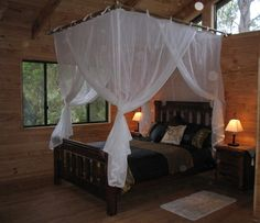 Hanging frame with curtains, now any bed can look like a relaxing four poster.