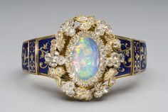Philadelphia Museum of Art - Collections Object : Gold with enamel decoration; opal, diamonds bracelet. Made in Paris, France, Europe. Date: c. 1849, Dimensions: 1 1/2 x 1 1/4 x 3 inches (3.8 x 3.2 x 7.6 cm), Curatorial Department: European Decorative Arts and Sculpture