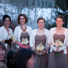 The bridesmaids wear brown chiffon gowns with cream cardigans