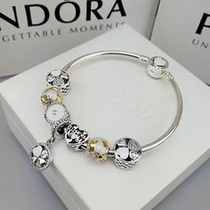 $165 authentic pandora charm bracelet with golden theme 7 pcs charms - Xingjewelry#pandora#charm#bracelet#snakechain#bracelet#heart#clasp#bangle#specialoffer#new#hot#affordableprice#muranoglass#charm#bead#eiffel#tower#pendant#black#flower (scheduled via http://www.tailwindapp.com?utm_source=pinterest&utm_medium=twpin)