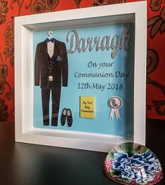 This beautiful little boy frame is for that special boy that is making his first holy communion. In the frame there is a navy/black dress suit hanging on a Xmas Frames, Box Frames, Communion Gifts, Confirmation Gifts, Glitter Cards, First Holy Communion, Frame Crafts, Craft Business, Silver Metal