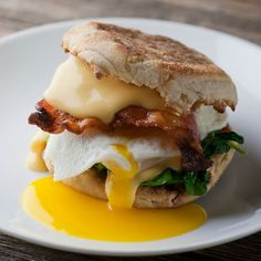 Bacon, egg, cheese, spinach all on an English muffin make up your favorite breakfast treat!