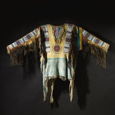 Oglala Sioux Beaded and Fringed Hide War Shirt | Lot | Sotheby's