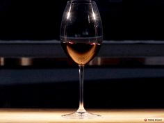 Why do people swirl wine? Find out why swirling improves the taste of wine and learn an easy trick to learn how to do it right.