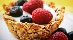 Breakfast granola cups, filled with yogurt and topped with your favorite fresh fruit, will be the star your next brunch gathering!