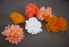DIY Crepe Paper Pom Pom Garland by Honestly Yum. I love the color combinations.