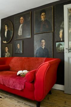 A brilliant way of displaying family portraits without frames + a sofa Godard would have approved of. Chez Renaud à Angouleme. Photo: Stephen Clement.