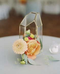 Initmate weddings need intimate centerpieces. Check out this golden geo terrarium and florals. Photo Credit: Erin Wilson Photography