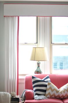 Gorgeous white curtains and cornice with coral piping (P 2284 Belfast, P 3457 Cole- Watermelon)  By caitlin wilson design: style files