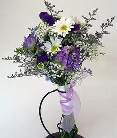 I am super excited about my bouquets--I didn't know that I would be so thrilled about flowers. :) Not quite this, but close enough.