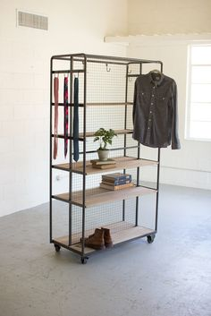 "Product Dimensions: 42"" x 20"" x 75.5""tThis versatile rolling storage rack is accessible from both sides. It comes with 10 movable hooks that can be used on the"