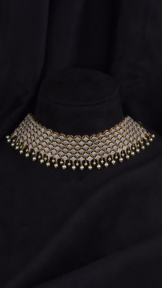 Shop for Azva Gold Choker Necklaces that are designed with exquisite nakshi work, intricate beauty of beads, granules and vibrancy of enamel work. Choker designs which will be cherished for a lifetime! Indian Bridal Jewelry Sets, Indian Jewelry Earrings, Jewelry Design Earrings, Necklace Designs, Bridal Jewellery, Jewelry Necklaces, Antique Jewellery Designs, Fancy Jewellery, Stylish Jewelry