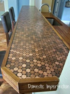 DIY Penny Countertop  I so want this for my bar