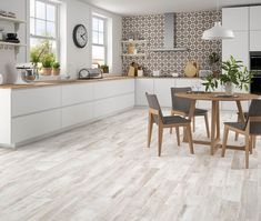 Mikeno Ash Wood Effect Wall And Floor Tiles - Mikeno from Tile Mountain Wall And Floor Tiles, Reception Rooms, Wood Planks, Porcelain Tile, Kitchen Flooring, Natural Wood, Ash, Contemporary, Table