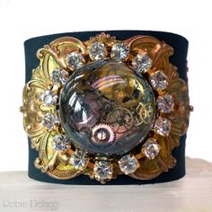 Steampunk Cuff Bracelet BlingPunk Black Leather Brass Resin Focal Rhinestone Chain B0086 by Robin Delargy LooLoo's Box Handcrafted Jewelry. $94.00, via Etsy.