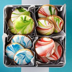 This holiday ginger spice cookie is easily decorated by dipping it in royal icing that has been swirled with food color for a marbleized effect.