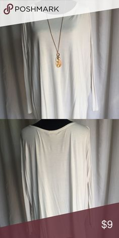 "Long Sleeve Cream Piko Top Long sleeve Piko top. Super soft and comfy! Can be wore with leggings and dressed up with a cute necklace. 95% Bamboo 5% Spandex I believe this is a Small but not positive. The tag has a T on it. Sleeves are 4"" laid flat at the smallest part. Supposed to fit tighter in the arm though. Tops Tunics"