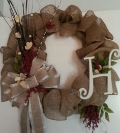 Monogram Burlap Wreath with burlap bow,  dried flowers and silk greenery.  PRICE $75.00