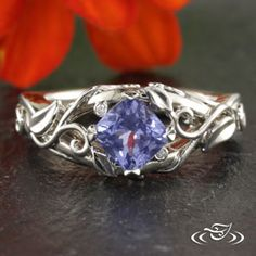 Cushion cut #sapphire in a curling leaf and vine #EngagementRing. #Ido #GreenLakeMade
