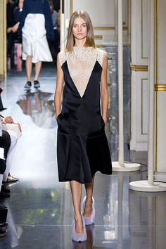 """Céline Spring 2013The other big news here were the shoes: fuzzy spa slippers and pumps. The idea? """"If I'm going out tonight, wouldn't it be nice if I could be as comfortable as if I were wearing my bedroom slippers?"""""""