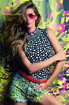 Neon Gisele – Gisele Bundchen teases amidst pregnancy rumors in a selection of colorful crop tops and skinny jeans for the July issue of Vogue Brazil. images lensed by Patrick Demarchelier. (Vogue Brazil)