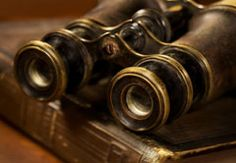 Photo about Old Binoculars resting on a book. could also be opera glasses. Image of eyepiece, binoculars, book - 17047989