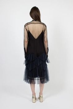 Dries Van Noten black and navy sheer Dalybe dress. Round neck leading to popper button front closure. Long sleeve with single popper button cuff.