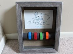 DIY: Turning Disney MagicBands into Wall Art - DIY: Magic Band Wall Art. Create this look with a shadowbox frame, empty paper towel roll, card stock, tape and a Disney thank-you card. You could also use a park map or Disney World travel brochure. Disney Home, Disney Diy, Walt Disney, Disney Crafts, Disney Dream, Orlando Disney, Disney Family, Disney Cruise, Disney Style