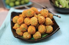 We're pretty sure these Cheese Stuffed Fried Green Olives will be the star of your ‪#‎OscarNight‬ party. YUM!