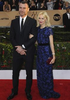 2016 SAG Awards - Liev Schreiber and Naomi Watts dressed with class. Liev went with a traditional tux for the awards. Naomi shook things up, she wore a lacy blue Burberry dress with a maroon Judith Leiber clutch.