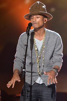 "Pharrell Williams the nominated ""Happy,"" from Despicable Me 2."