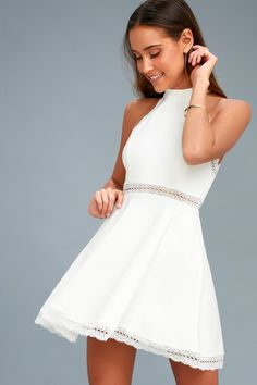 Lulus Exclusive! The Reach Out My Hand White Lace Skater Dress will be there for any fashion emergency! This medium-weight stretch knit dress has a high halter neckline and fitted bodice with princess seams. Panels of sheer lace accent the waist and hem of the flirty skater skirt. Hidden back zipper.