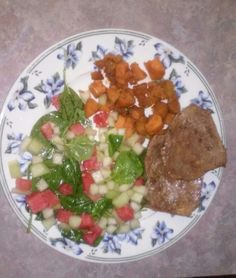 Petite steaks sprinkled w/ beef seasoning w/ a side of brown sugar honey carmelized sweet potatoes & a side of spinach leaves mixed in italian dressing topped w/ diced watermelon & sweet honey due melon