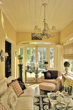 beautiful enclosed porch. Love the light and airy feel of this room.