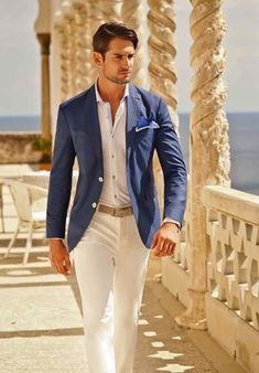 medium blue fitted blazer, light blue shirt, off-white pants, royal blue pocket square, khaki belt