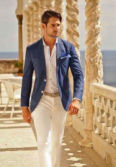 medium blue fitted blazer, light blue shirt, off-white pants, royal blue pocket square, khaki belt