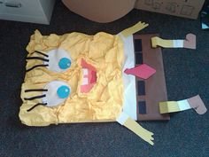SpongeBob costume for Book week made out of crinkled bulletin board paper, bulletin board paper, and glued on cardboard.  String was hooked on other side for student to wear like a necklace.