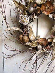 """Christmas Wreath - I took this idea and used white sea shells.  some, I painted silver or gold. Using hot glue, I attached them all around a store bought wreath and hung in an outdoor area for """"Christmas by the Sea"""" My guests loved it!"""