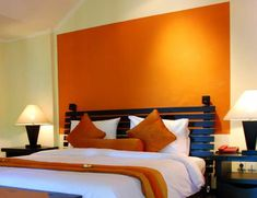 outsized your space with these inspiring wall colors for small rooms accent wall with orange - Colors For Walls In Bedrooms