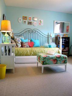 love the idea of an ottoman in a teens bedroom.  Good colour.