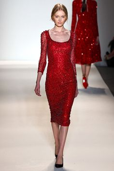 Jenny Packham Fall 2013.  Beautiful cherry red sheath gown, covered with spangles.  Scoop neck with sheer 3/4 length sleeves