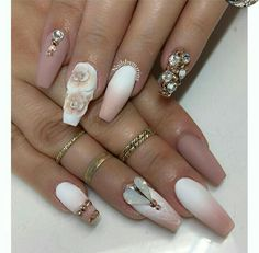 Very beautiful nails. Brown and white and flowers