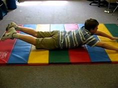 The second exercise to help integrate the Tonic Labyrinthine Reflex (TLR) is called superman.  The child will lay on his stomach, put his arms above his head and lift up his arms and his legs so that  his knees are off the mat and fly like superman for 15 seconds.  Again, 2 sets of 15 seconds for this integration exercise.
