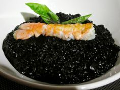 Black Rice (Arròs Negro) - cooked with squid ink and pieces of squid or cuttlefish.