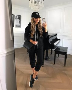 Fashion blogger mia mia mine wearing a black jogger set from target. For more cute gym outfits, sweat suits for women, and chic athleisure looks, click through to my blog. #gymstyle #athleisure #lookoftheday