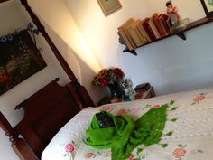 Frida's bedroom at Casa Azul #casaazul #fridakahlo #bedroom #green #mask