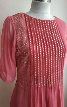Description: Hand done sequin work Fine Pintucks detailing Length at the centre, longer on the sides Styling Tip: Pair withPeach gharara set with mukaish dupatta – Artofit Salwar Designs, Kurta Designs Women, Kurti Designs Party Wear, Neck Designs For Suits, Dress Neck Designs, Designs For Dresses, Blouse Designs, Sleeve Designs, Designer Kurtis